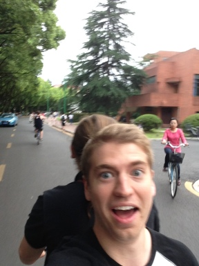 Riding on the back of my bike, backwards, Abby pedaling...